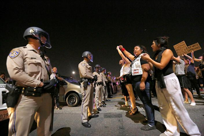 <p>Los Angeles Police Department officers are deployed as demonstrators take over the Hollywood 101 Freeway just north of Los Angeles City Hall in protest to the election of Republican Donald Trump as President of the U.S. in Los Angeles, Calif., Nov. 10, 2016. (Photo: Mario Anzuoni/Reuters) </p>