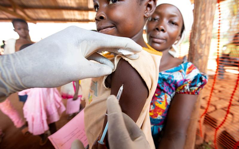 A child receives a measles vaccination in a campaign run by Medecins sans Frontieres in Democratic Republic of Congo - Hereward Holland/Reuters