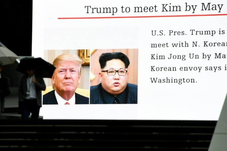 News of Donald Trump's plan to meet with Kim Jong Un, beamed onto on a giant screen in Tokyo