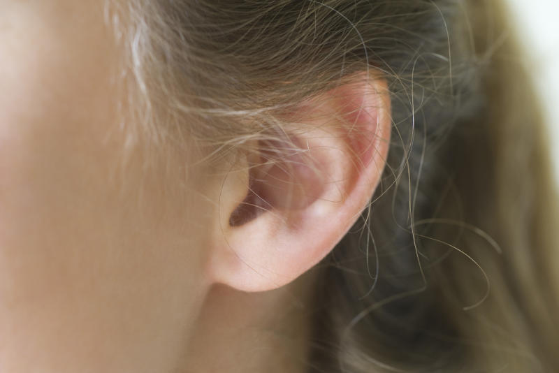 New research has revealed ear 'tickle' therapy could help slow down the ageing process [Photo: Getty]