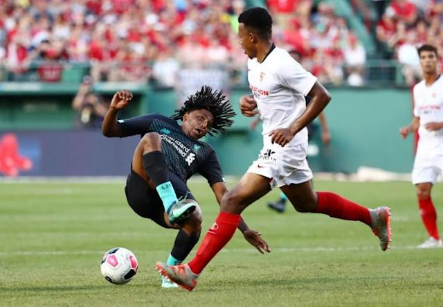 Yasser Larouci of Liverpool is fouled by Sevilla's Joris Gnagnon in Sevilla's 2-1 win in a pre-season friendly at Fenway Park (AFP Photo/Tim Bradbury)