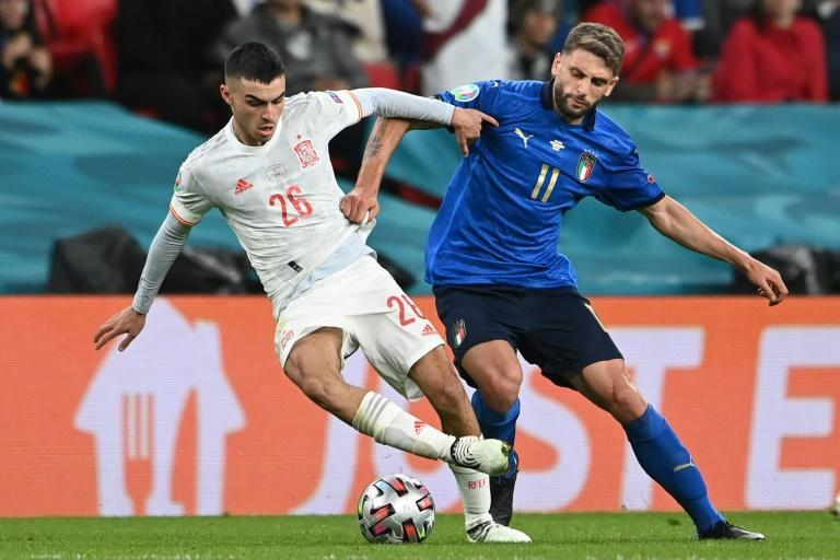 Teenage sensation: Pedri (left) has been a star for Spain at Euro 2020