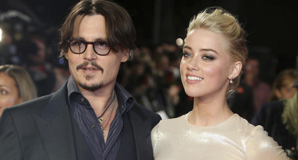 Johnny Depp and Amber Heard pose on the red carpet for a film premiere in 2011.