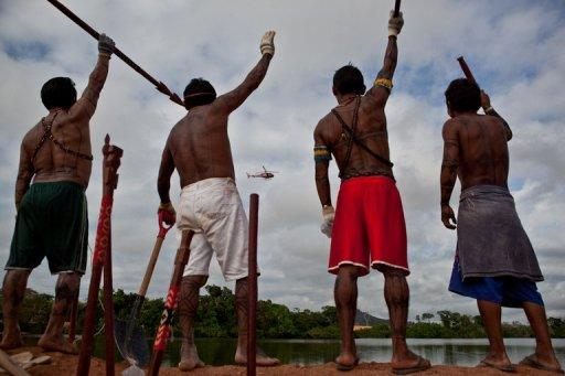Amazonic natives symbolically occupy an earthen dam over the Xingu River in Para, northern Brazil, in June 2012