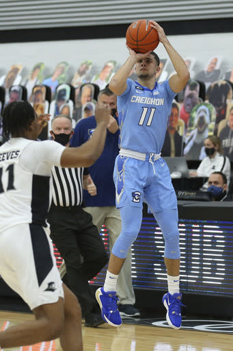 Creighton's Marcus Zegarowski (11) shoots a 3-pointer during the second half of an NCAA college basketball game against Providence Saturday, Jan. 2, 2021, in Providence, R.I. (AP Photo/Stew Milne)
