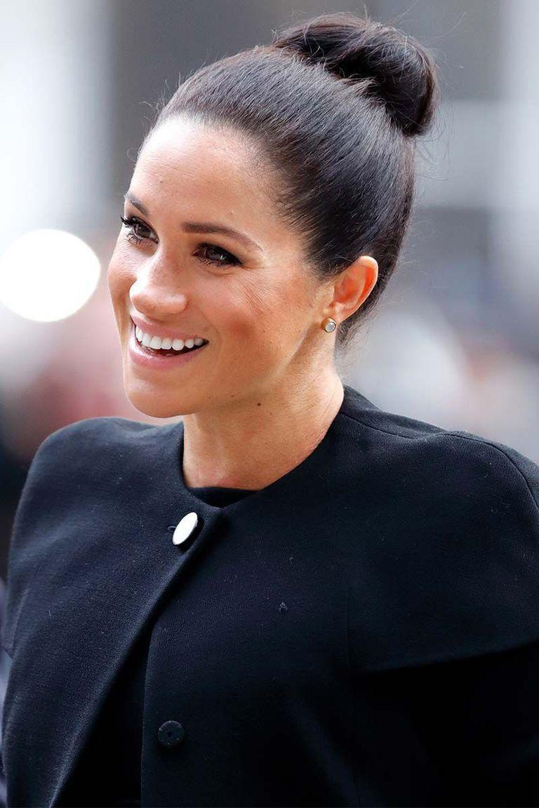 <p>The Duchess of Sussex made top buns feel chic again with her pulled-back hairstyle at an engagement with the Association of Commonwealth Universities.</p>