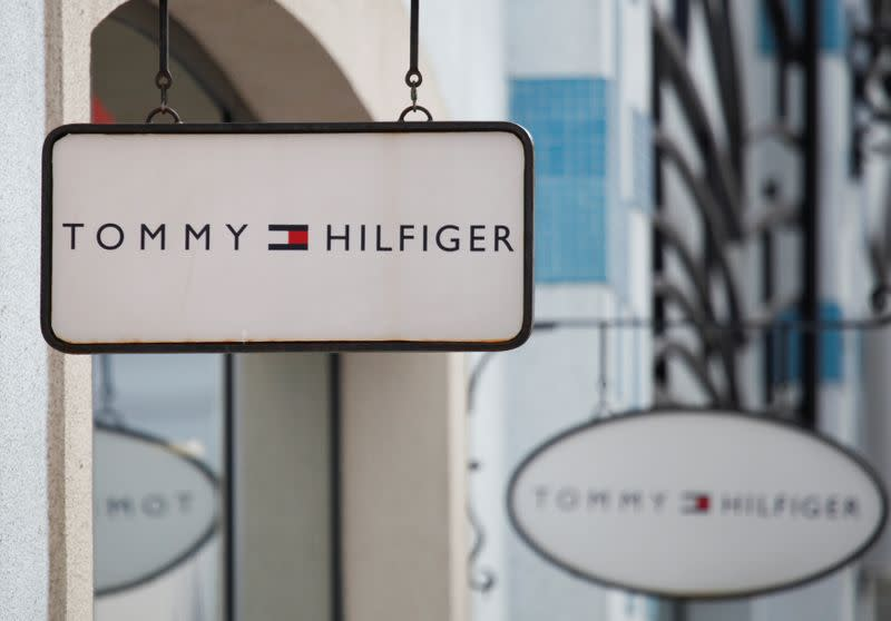 FILE PHOTO: Boards with Tommy Hilfiger store logo are seen on a shopping center at the outlet village Belaya Dacha outside Moscow