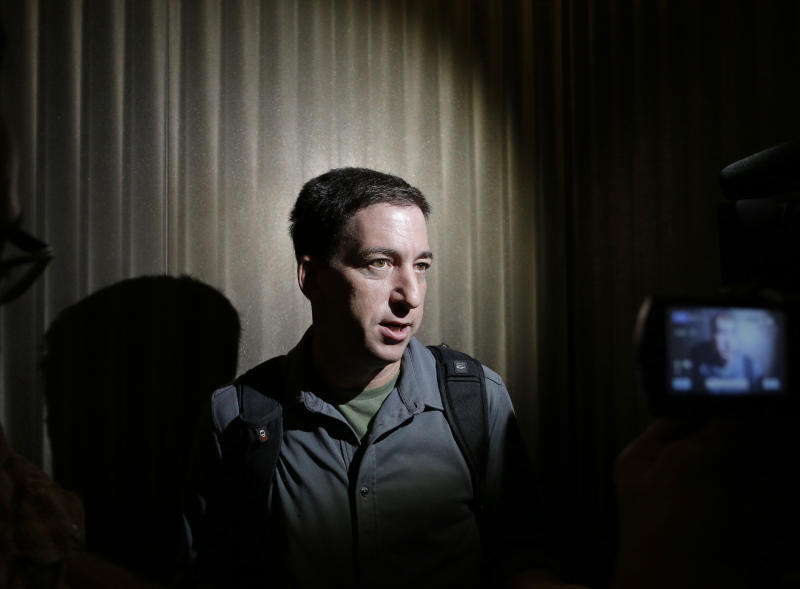 "FILE - In this June 10, 2013, file photo The Guardian reporter Glenn Greenwald speaks to reporters at his hotel in Hong Kong. Greenwald first reported former NSA contractor Edward Snowden's disclosure of NSA's government surveillance programs. On Sunday's ""Meet the Press"", June 23, 2013, host David Gregory asked Greenwald why he shouldn't be charged with a crime for having ""aided and abetted"" Snowden. Greenwald replied that it was ""pretty extraordinary that anybody who would call themselves a journalist would publicly muse about whether or not other journalists should be charged with felonies."" (AP Photo/Vincent Yu, File)"