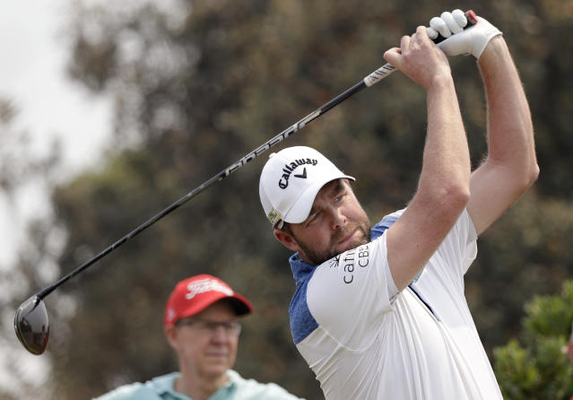 Australia's Marc Leishman tees off on the 12th hole during the Australian Open Golf Pro-AM in Sydney, Wednesday, Dec. 4, 2019. The Australian Open begins Thursday. (AP Photo/Rick Rycroft)