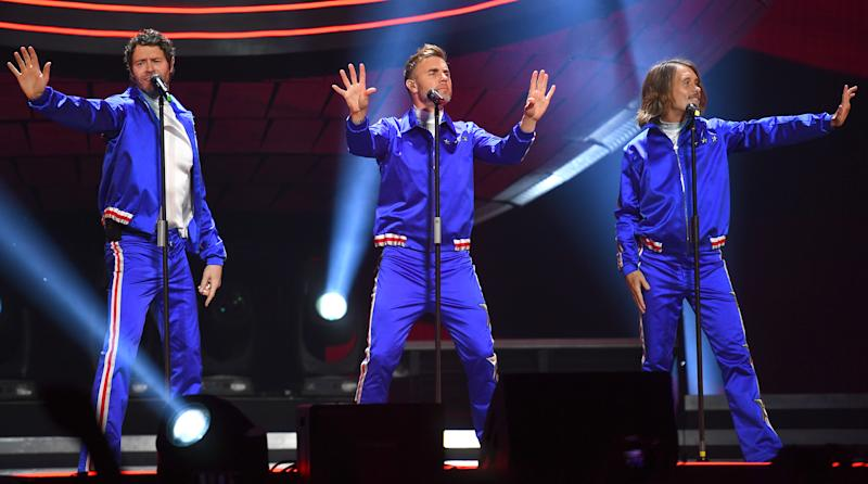 Take That perform on stage at the FlyDSA Arena on April 12, 2019 in Sheffield, England. (Photo by Dave J Hogan/Getty Images for Take That)