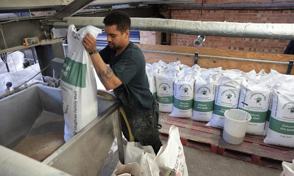 Sacks of malt emptied into the mix at Gipsy Hill Brewery in south London.
