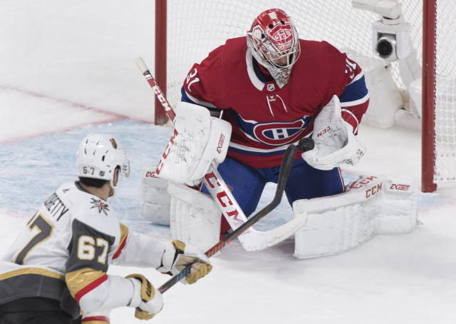 Vegas Golden Knights' Max Pacioretty (67) shoots against Montreal Canadiens goaltender Carey Price during first-period NHL hockey game action in Montreal, Saturday, Jan. 18, 2020. (Graham Hughes/The Canadian Press via AP)
