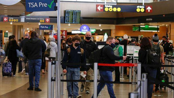 PHOTO: In this April 12, 2021, file photo, people queue in a security checkpoint at Seattle-Tacoma International Airport in SeaTac, Washington. (Lindsey Wasson/Reuters, FILE)