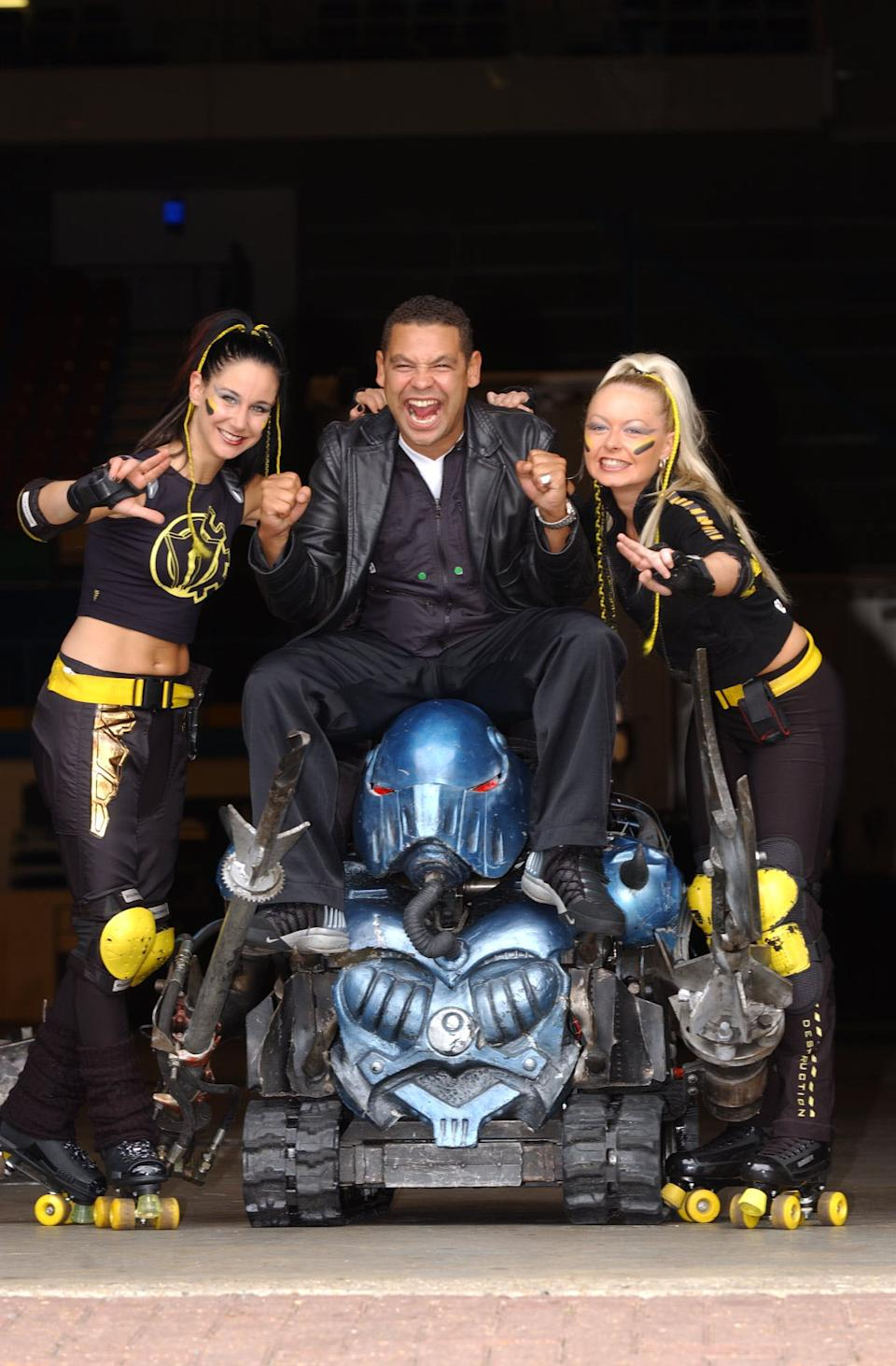 Robobabes Emily Vincent and Kelly Allen with presenter Craig Charles and the house robots promoting The Robot Wars Live Event, taking place at the London Arena and at the Wembley Arena.