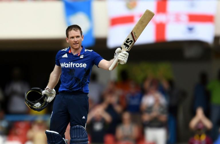 England's cricket team captain Eoin Morgan celebrates after scoring his century during their One Day International against the West Indies in St. John's, Antigua, on March 3, 2017