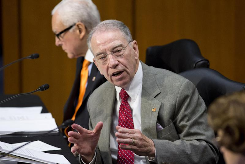 "Sen. Chuck Grassley, R-Iowa, ranking member of the Senate Judiciary Committee, defends his amendment to prohibit anyone from obtaining legal status until the Homeland Security Department has maintained ""effective control"" of the border for six months, as lawmakers examine proposed changes to immigration reform legislation, on Capitol Hill in Washington, Thursday, May 9, 2013. Sen. Orrin Hatch, R-Utah, sits at top. Grassley's amendment was later voted down 12 to 6.  (AP Photo/J. Scott Applewhite)"