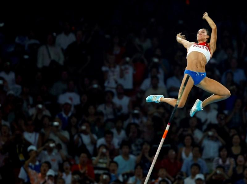 FILE PHOTO: Yelena Isinbayeva of Russia competes during the women's pole vault final at the Beijing 2008 Olympic Games
