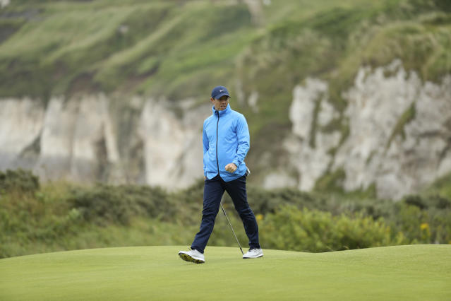 Northern Ireland's Rory McIlroy walks across the 5th green during a practice round ahead of the start of the British Open golf championships at Royal Portrush in Northern Ireland, Wednesday, July 17, 2019. The British Open starts Thursday. (AP Photo/Peter Morrison)