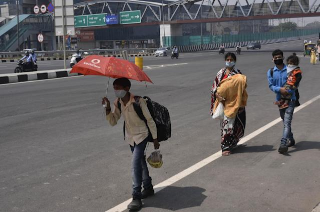 Migrants headed to their homes in Bihar spotted walking along Dhaula Kuan during lockdown relaxation in New Delhi. (Photo by Vipin Kumar/Hindustan Times via Getty Images)