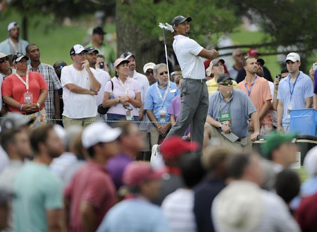 Tiger Woods drops his club after hitting from the second tee during the second round of the Quicken Loans National golf tournament, Friday, June 27, 2014, in Bethesda, Md. (AP Photo/Nick Wass)