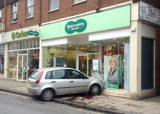 should have gone to specsavers car crashes into optician s shop  should have gone to specsavers car crashes into optician s shop window