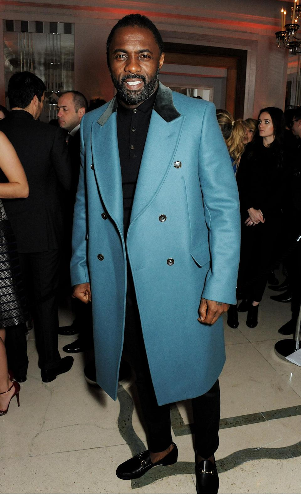 <p>Idris Elba arrives at the Harper's Bazaar Women of the Year awards at Claridge's Hotel in London wearing a bright teal coat on Nov. 5, 2013. (Photo: Getty Images) </p>