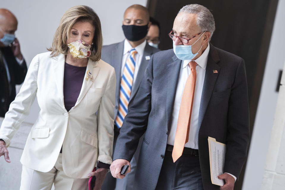 Speaker Nancy Pelosi and Senate Minority Leader Charles Schumer make their way to a news conference on coronavirus aid in the Capitol Visitor Center on Thursday, August 6. (Photo By Tom Williams/CQ-Roll Call, Inc via Getty Images)