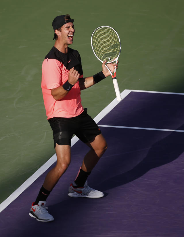 Thanasi Kokkinakis, of Australia, celebrates after defeating Roger Federer, of Switzerland, in a tennis match at the Miami Open, Saturday, March 24, 2018, in Key Biscayne, Fla. (AP Photo/Wilfredo Lee)