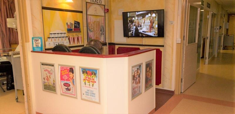 Cinema booth at the Hull Royal Infirmary, where patients can watch footage of old street scenes and sporting events from the 1950s and 1960s (PA)