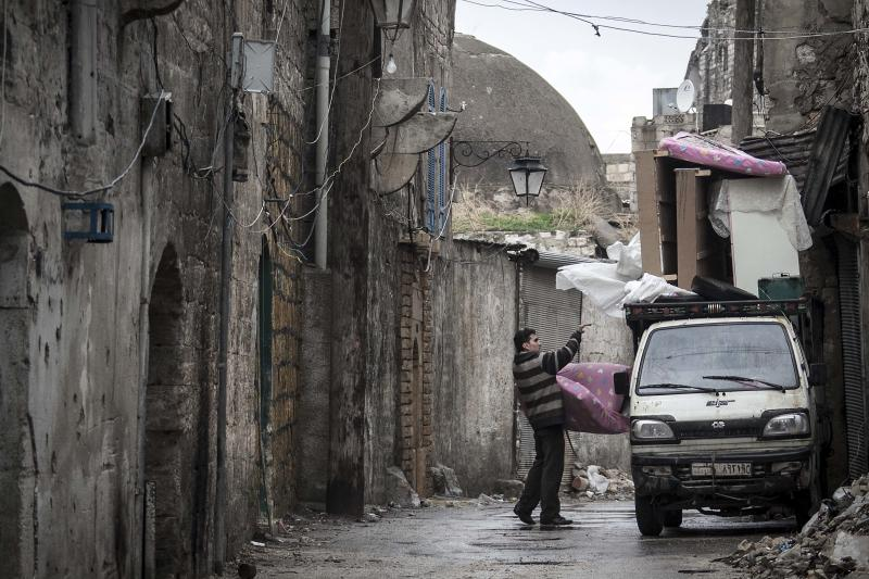 A Syrian man loads his belongings on a truck to flee due to fighting between Free Syrian Army fighters and government forces in Aleppo, Syria, Tuesday, Dec. 4, 2012. (AP Photo/Narciso Contreras)