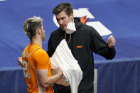 Injured Tennessee forward John Fulkerson talks with Santiago Vescovi (25) in the first half of an NCAA college basketball game against Alabama in the Southeastern Conference Tournament Saturday, March 13, 2021, in Nashville, Tenn. (AP Photo/Mark Humphrey)