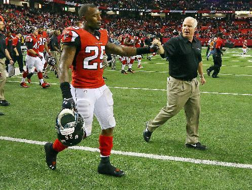 Atlanta Falcons head coach Mike Smith, right, and safety William Moore celebrate a 27-26 victory over the Washington Redskins as time expires in a NFL football game on Sunday, Dec. 15, 2013, in Atlanta. (AP Photo/Atlanta Journal-Constitution, Curtis Compton)