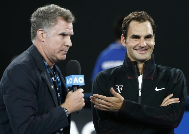 Tennis - Australian Open - Rod Laver Arena, Melbourne, Australia, January 16, 2018. Roger Federer of Switzerland speaks with actor Will Ferrell after winning his match against Aljaz Bedene of Slovenia. REUTERS/Thomas Peter