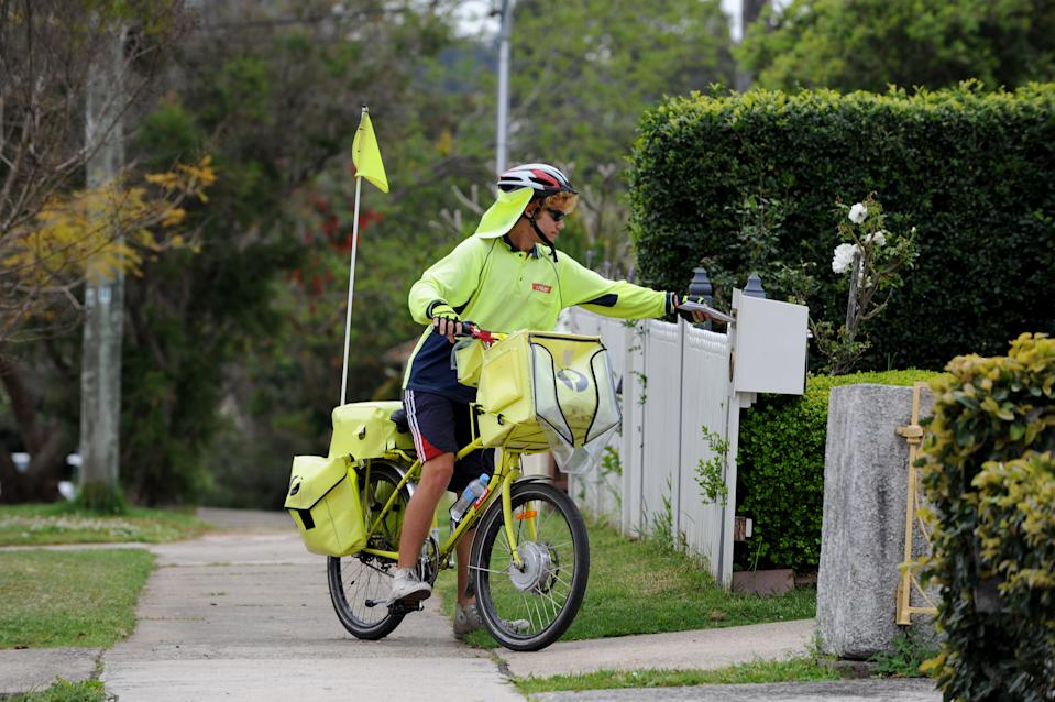 An Australia Post worker delivers mail by pushbike in Sydney. Source: AAP