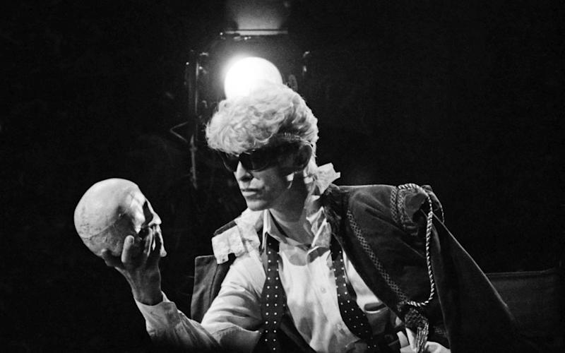 Bowie pictured performing to a skull - Janet Macoska