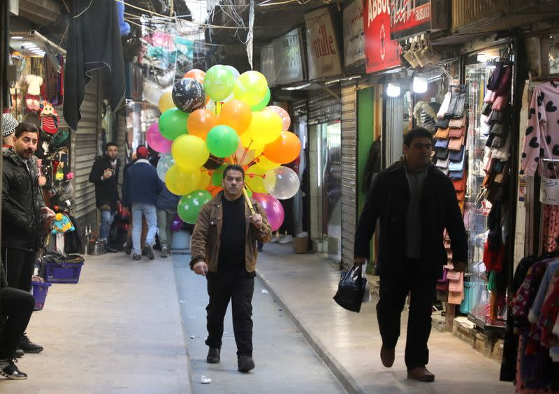 A man sells balloons at a souk, during a lockdown to curb the spread of the coronavirus disease (COVID-19), in Tripoli