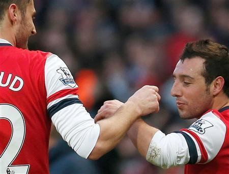 Arsenal's Santi Cazorla (R) celebrates with teammate Olivier Giroud after scoring a second goal against Fulham during their English Premier League soccer match at the Emirates stadium in London January 18, 2014. REUTERS/Suzanne Plunkett