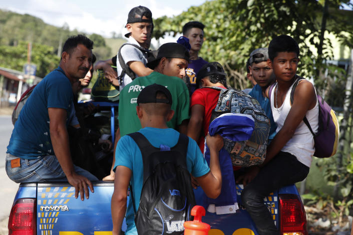 Honduras migrants trying to reach the United States get in the bed of a police pickup truck as they are directed back to Honduran border, in Morales, Guatemala, Wednesday, Jan. 15, 2020. Hundreds of mainly Honduran migrants started walking and hitching rides Wednesday from the city of San Pedro Sula and crossed the Guatemala border in a bid to form the kind of migrant caravan that reached the U.S. border in 2018. (AP Photo/Moises Castillo)