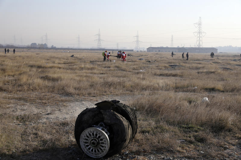 Debris is seen from an Ukrainian plane which crashed as rescue workers search the scene in Shahedshahr southwest of the capital Tehran, Iran, Wednesday, Jan. 8, 2020. (Photo: Ebrahim Noroozi/AP)
