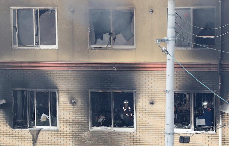 Firefighters inside an animation company building which was attacked (Photo credit should read JIJI PRESS/AFP/Getty Images)