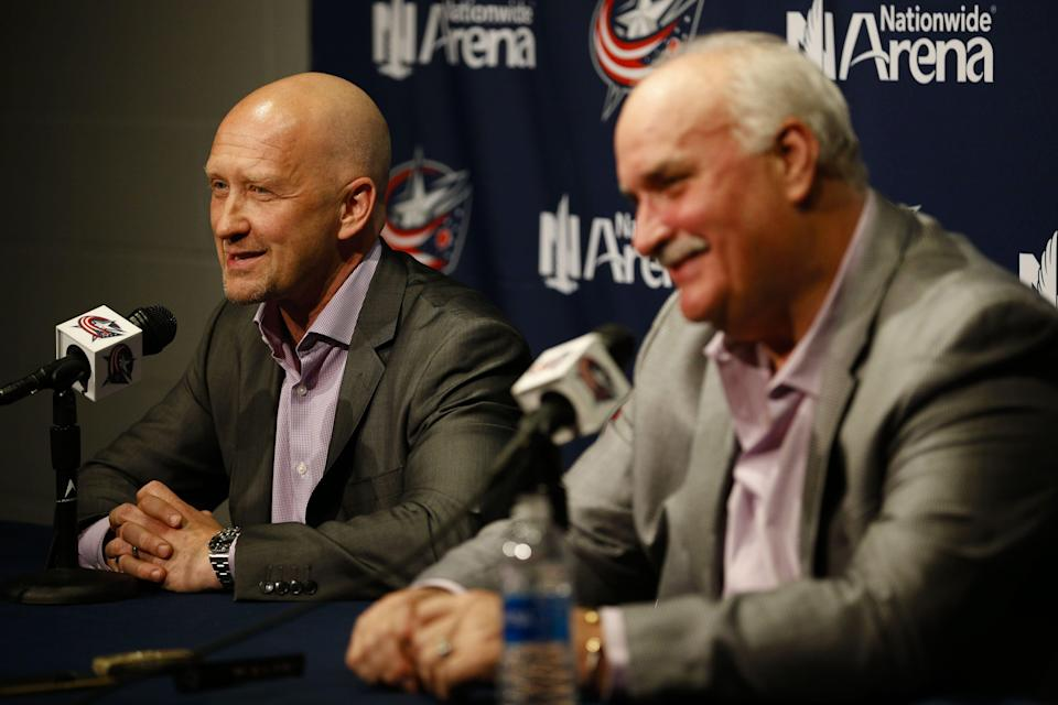 Jarmo Kekalainen, general manager of the Columbus Blue Jackets, left, answers a question as John Davidson, president of hockey operations, right, smiles during an end-of-season press conference on Monday, April 24, 2017 at Nationwide Arena.