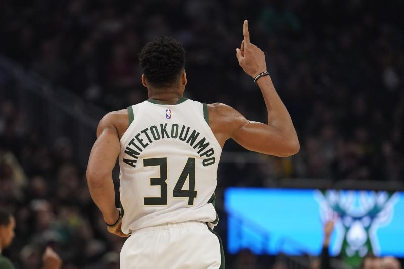 Milwaukee Bucks' Giannis Antetokounmpo reacts after a dunk during the first half of an NBA basketball game against the Cleveland Cavaliers Saturday, Dec. 14, 2019, in Milwaukee. (AP Photo/Morry Gash)