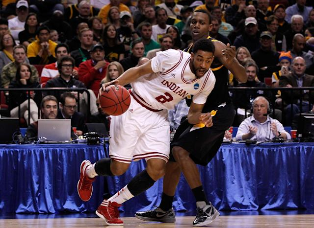PORTLAND, OR - MARCH 17: Christian Watford #2 of the Indiana Hoosiers drives on Treveon Graham #21 of the Virginia Commonwealth Rams in the second half during the third round of the 2012 NCAA Men's Basketball Tournament at the Rose Garden Arena on March 17, 2012 in Portland, Oregon. (Photo by Jonathan Ferrey/Getty Images)