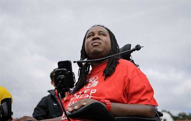 Former Rutgers football player Eric LeGrand looks up at the stands during ceremony where his jersey number 52 was retired at halftime of an NCAA college football game against Eastern Michigan in Piscataway,N.J., Saturday, Sept. 14, 2013. LeGrand became paralyzed while making a tackle in an October 2010 game. (AP Photo/Mel Evans)