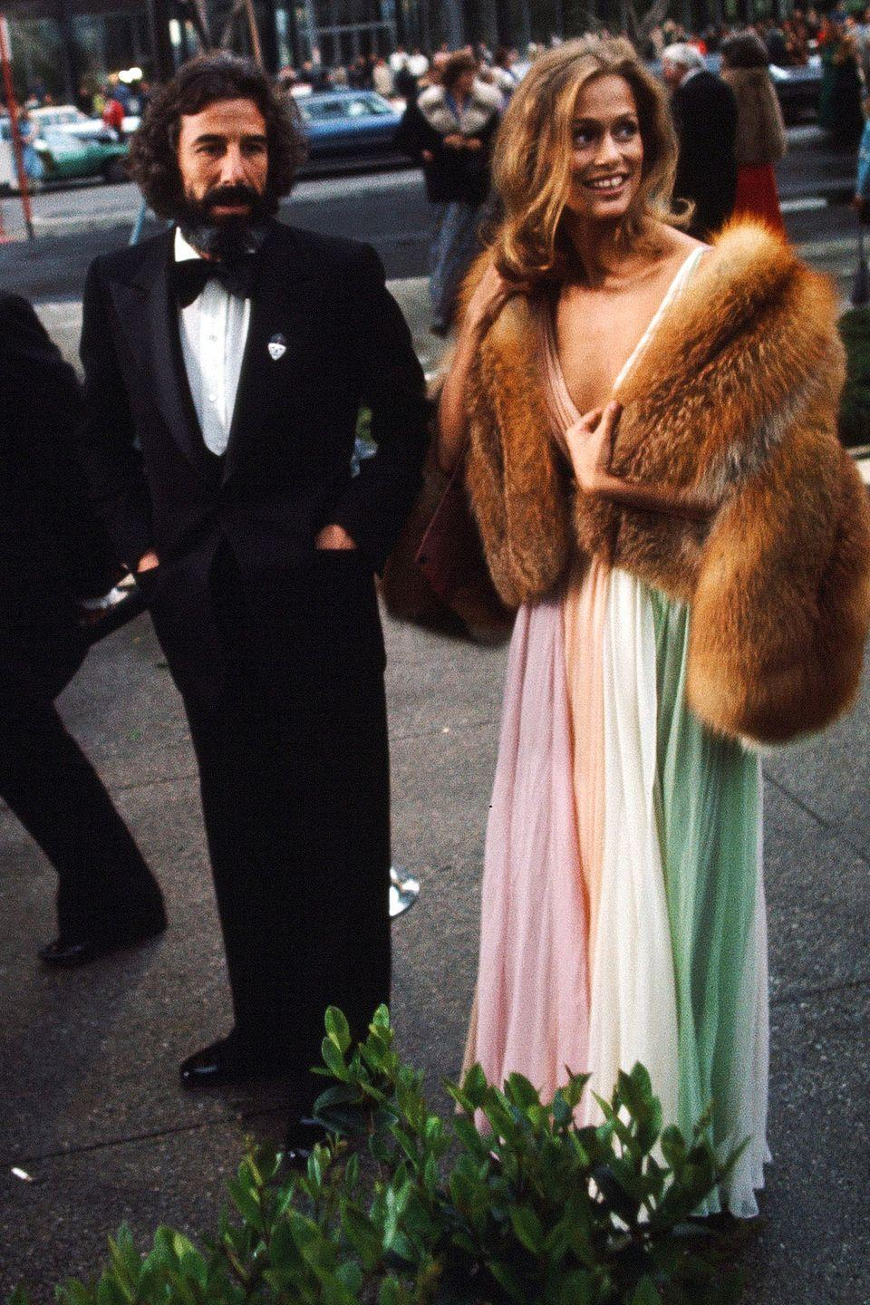 <p>Lauren Hutton was an example of the relaxed glamour of the '70s in her rainbow Halston gown and chubby fur jacket.</p>