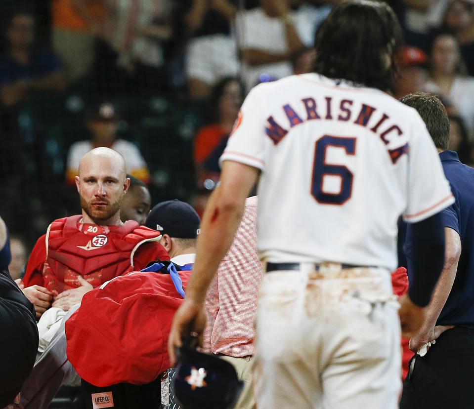 HOUSTON, TEXAS - JULY 07: Jonathan Lucroy #20 of the Los Angeles Angels of Anaheim is tended to by medical staff after a collision at home plate with Jake Marisnick #6 of the Houston Astros in the eighth inning at Minute Maid Park on July 07, 2019 in Houston, Texas. (Photo by Bob Levey/Getty Images)