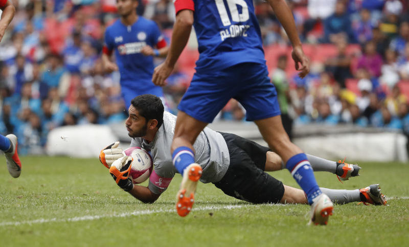 Cruz Azul's goalkeeper Jesus Corona catches the ball during a Mexico soccer league match against Monterrey during a Mexico soccer league match in Mexico City, Saturday, Oct. 6, 2018. (AP Photo/Eduardo Verdugo)