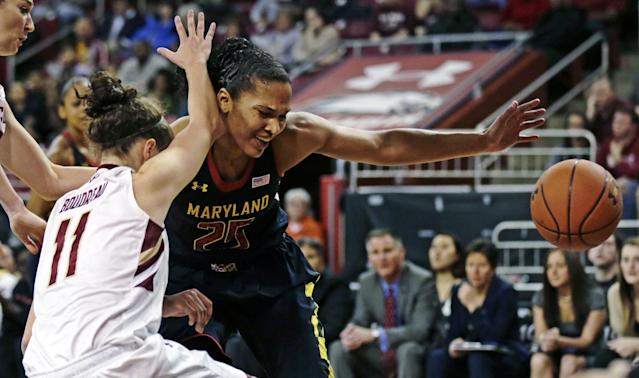 Maryland forward Alyssa Thomas (25) loses control of the ball as she slams into Boston College guard Nicole Boudreau (11) on a drive to the basket during the first half of an NCAA college basketball game, Thursday, Feb. 27, 2014, in Boston. (AP Photo/Charles Krupa)