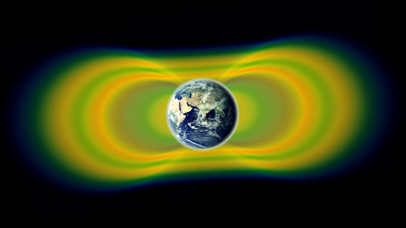 This artist rendering provided by NASA shows the Van Allen radiation belts around Earth. A new study published Thursday Feb. 28, 2013, in the journal Science reports that NASA's recently launched twin satellites to the region discovered a third, temporary ring. It appeared for a month before a shock wave from the sun destroyed it. Scientists are still trying to figure out how often this happens.  (AP Photo/NASA)