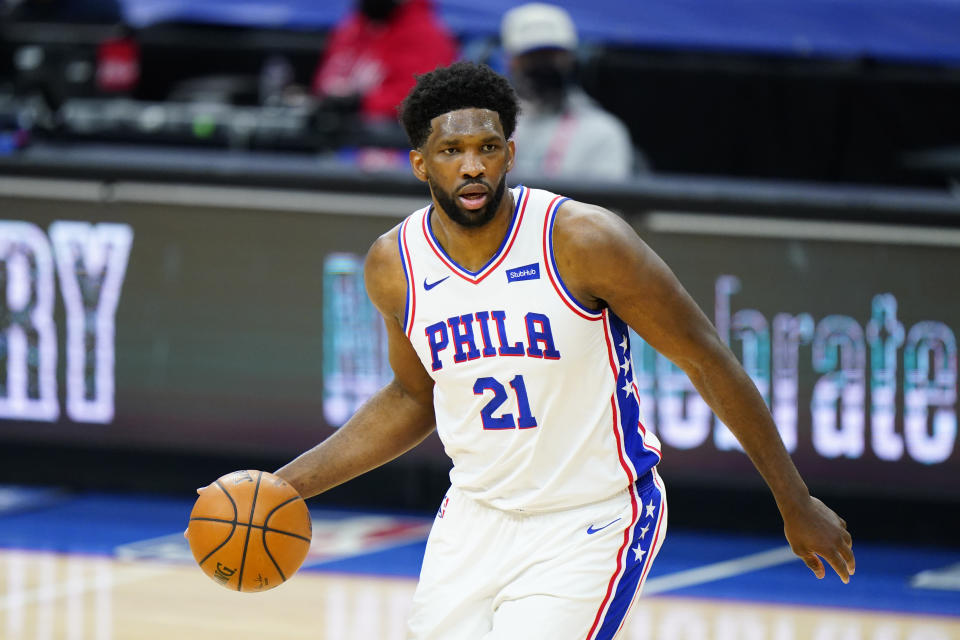 FILE - In this Feb. 17, 2021, file photo, Philadelphia 76ers' Joel Embiid dribbles during an NBA basketball game against the Houston Rockets in Philadelphia. Embiid is having the best season for a 76ers big man since Moses Malone and he has his team atop the Eastern Conference standings headed into the second half of the season. (AP Photo/Matt Slocum, File)